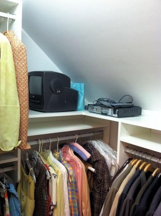 sloped closet ceiling storage solution
