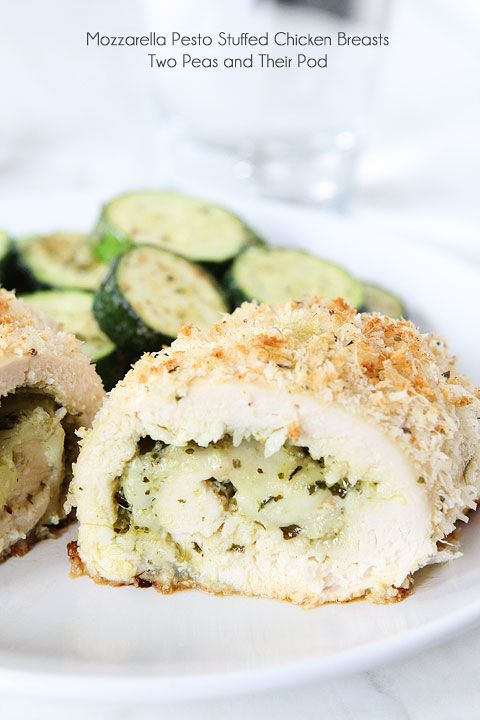 Mozzarella Pesto Stuffed Chicken Breasts Recipe on twopeasandtheirpod.com Baked chicken with a cheesy pesto filling and a panko parmesan crust! Easy to make too!