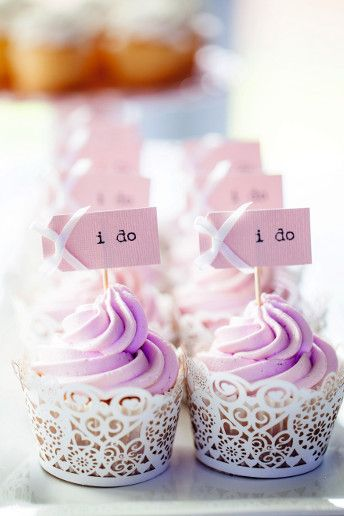 Lavender cupcakes with paper lace wrappers.