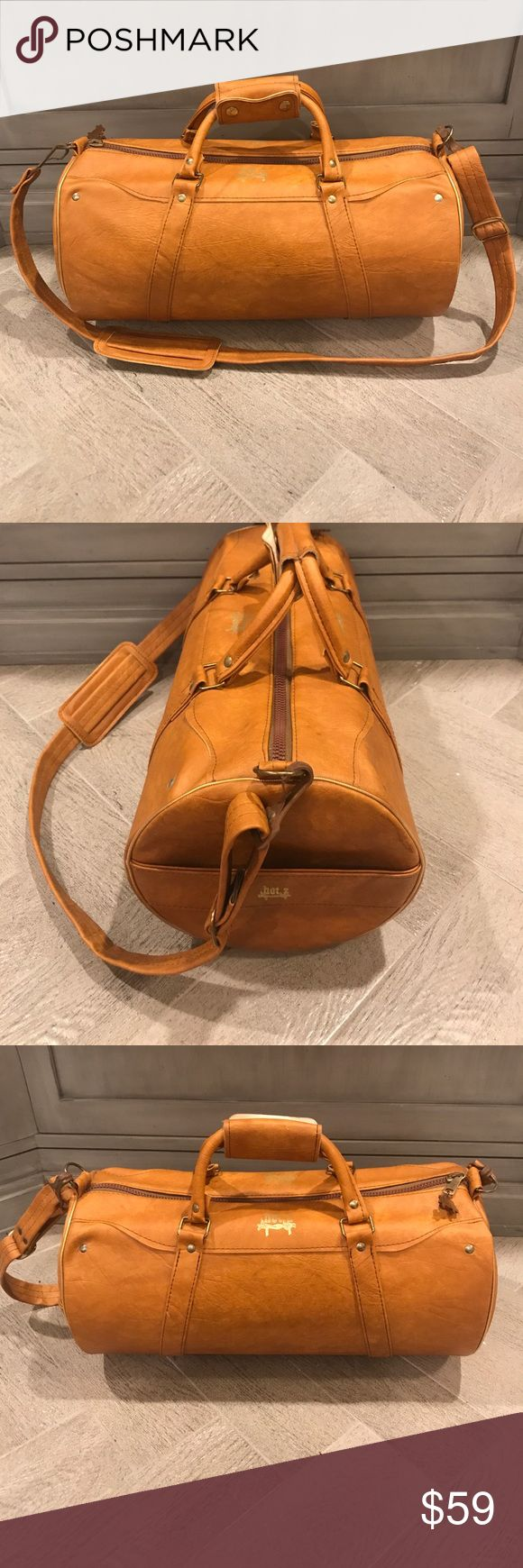 Vintage hot z  cylindrical bag As new as you could wish for in a vintage bag. Unique cylindrical shape stands out from the crowd. Would make a stylish carry-on. Saddle color durable vinyl. Bags Luggage & Travel Bags