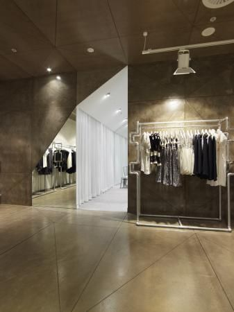 Uscari by Greg Natale Design  I like the contrast between the shop floor and the changing rooms, it is really striking