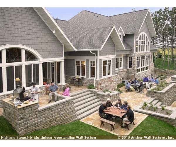 raised patio featuring highland stone wall system - Raised Patio Ideas