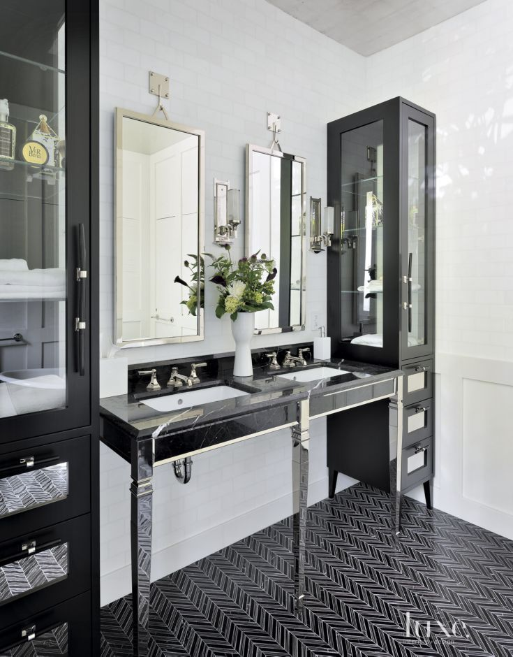 Cabinets fabricated by Seattle Cabinet & Design sandwich a Devon & Devon vanity purchased through Cabochon Surfaces & Fixtures in La Jolla, California, which rests on flooring from Ann Sacks. Thomas also conceived the mirrors fabricated by Metal Solutions in this contemporary bathroom. #LuxeTurns10