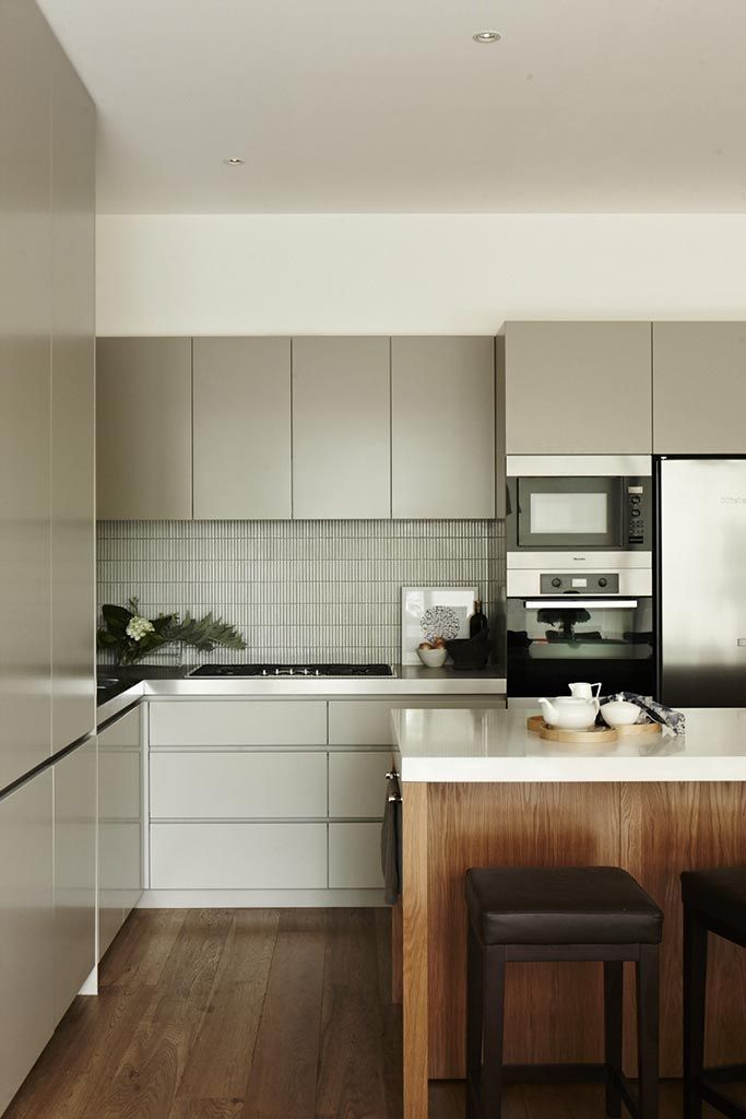 Timber warms up the moody grey tones of this kitchen by Chelsea Hing