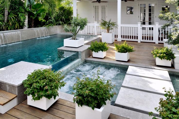 Featuring an infinity edge lap pool, hot tub, concrete stepping pads and ipe decking, this small backyard spares no luxury despite its limited space.