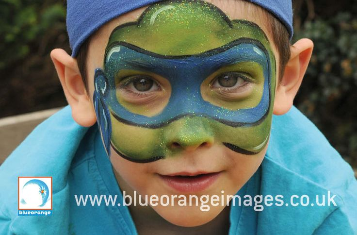 Blue Orange Images facepainting Watford, Boy with teenage mutentent hero turtle face paint design with green glitter