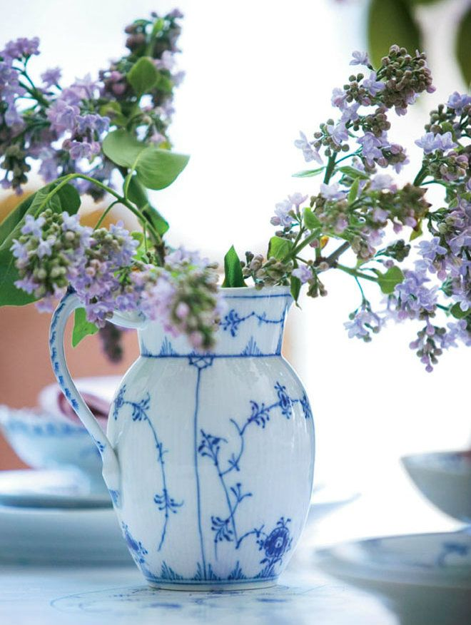 The Blue Fluted Plain Jug can be used for more than just beverages. Here used as a beautiful vase with lilacs.