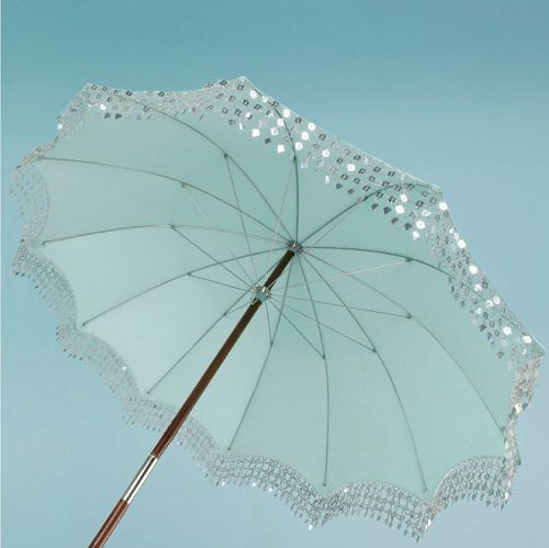 Love the idea of a blingy umbrella.  Make even gray days sparkle & shine!  :o)