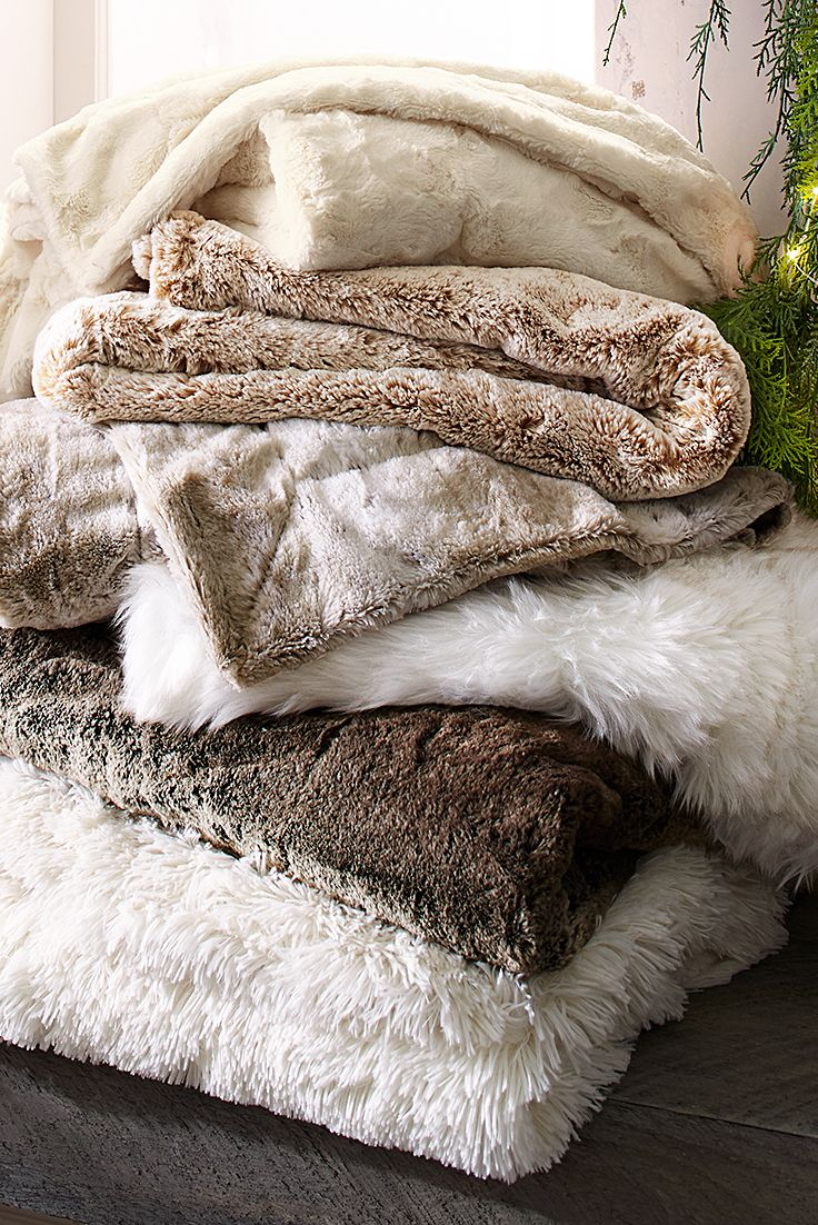 The fur may be faux, but the comfort is real in the Pier 1 Fur Shop. And the joy will be real for anyone who receives this unique kind of Christmas wrapping, ideal for wrapping up on a cold winter's night. Choose a luxurious faux fur throw, and maybe add a couple of snuggly soft faux fur pillows for good measure.