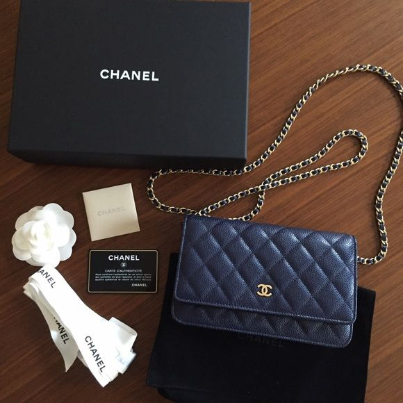 Authentic NiB Chanel navy blue caviar woc Authentic NiB Chanel navy blue caviar with gold hardware woc bag. Can be worn cross body or with a double chain. Can also be carried as a clutch. Guaranteed authentic, as I purchased it directly from the Chanel boutique. Comes with full set as pictured. Don't miss out!! CHANEL Bags Crossbody Bags