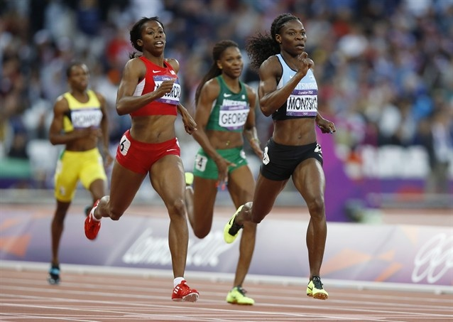 Botswana's Amantle Montsho, front right, and United States' Francena McCorory, front left, compete in a women's 400-meter semifinal.