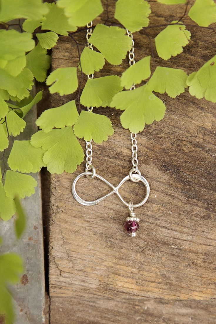 Beautiful Infinity Charm Necklace with Birthstone Accent by Jules Jewelry