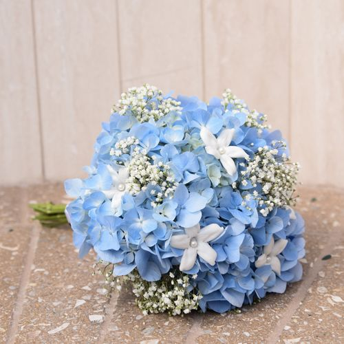 Something Blue Bridal Bouquet. Blue wedding flowers on your wedding day can be your something blue.