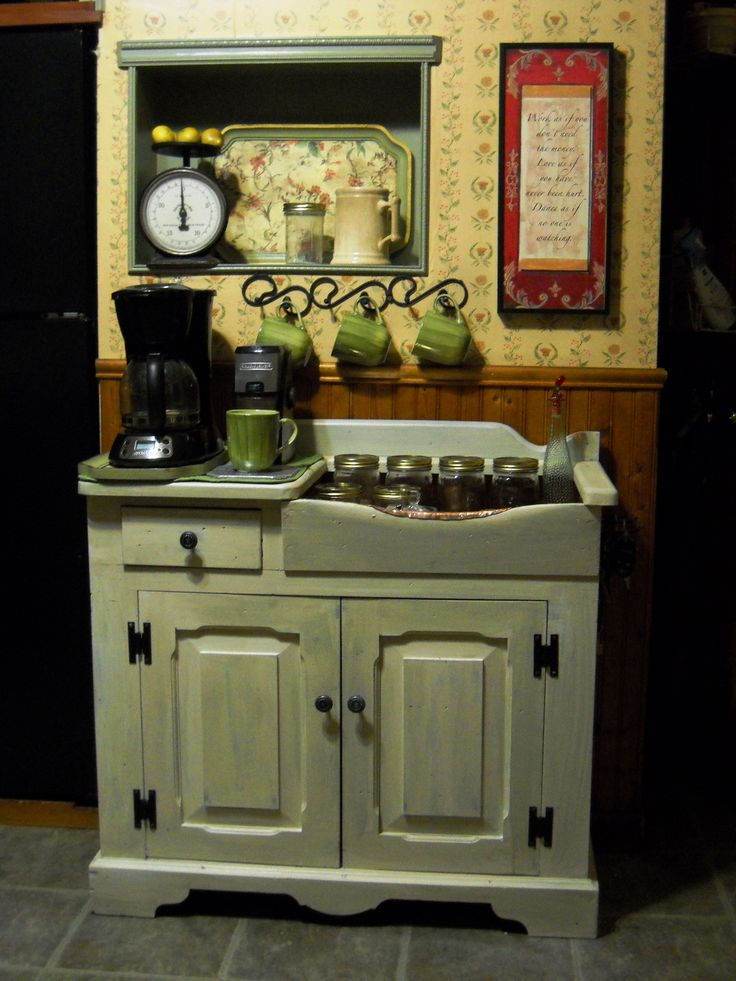 we refinished and made into a coffee station dry sink 2 wet bar