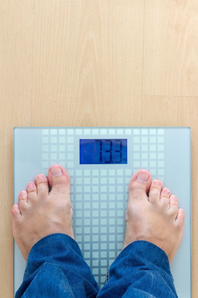 Man standing on weight scale by OSORIOartist on Creative Market