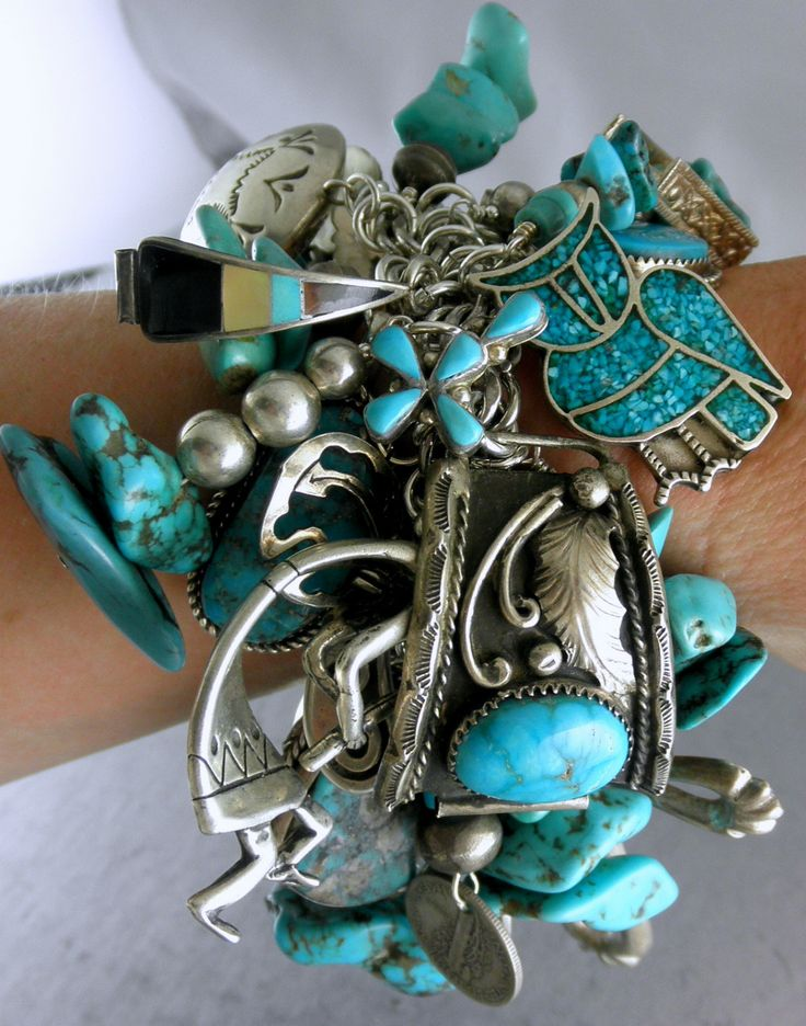 Charm Bracelet | Sterling silver and turquoise; combining 56 Pawn Navajo charms | | Many of the charms are signed