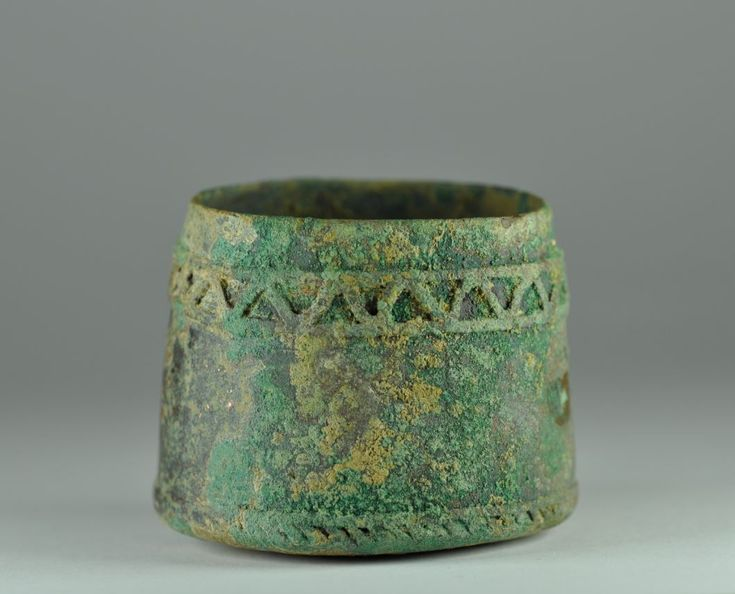 Amlash bronze cup, 1st millenium B.C. Amlash Luristan Bactrian bronze cup with banded decoration on the top and on the base, 5 cm high. Private collection