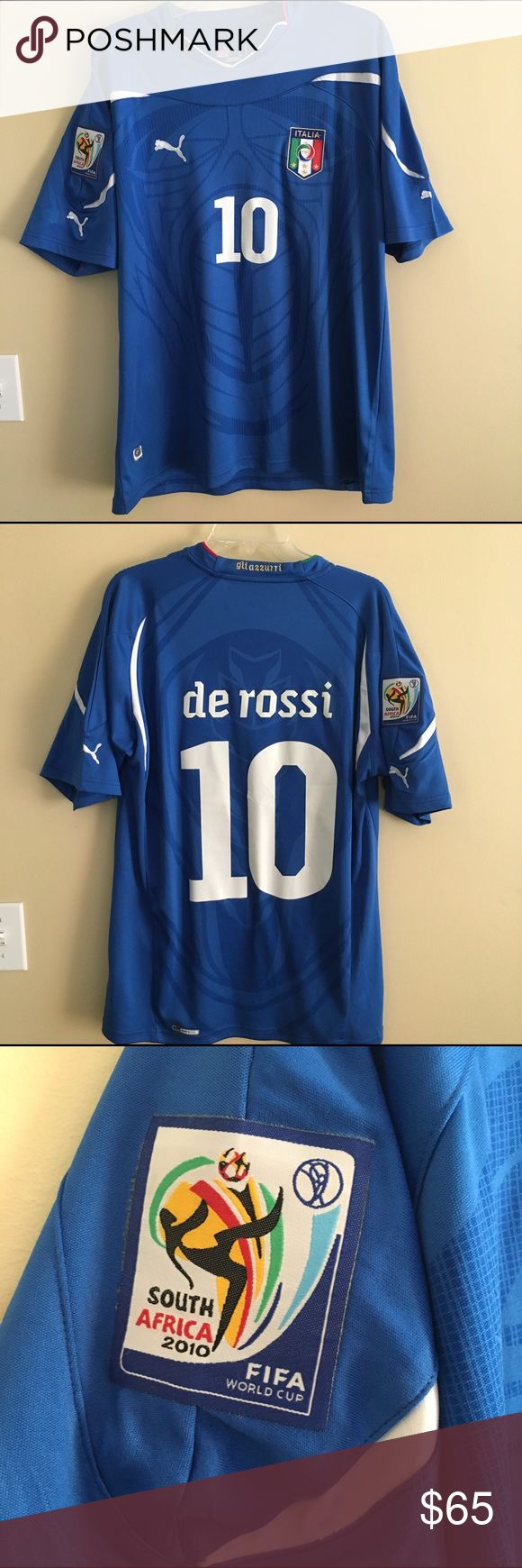 "NWOT Italia 2010 World Cup #10 De Rossi jersey, L NWOT Team Italia jersey from Puma, size Large. Embroidered logo patch on front ""ITALIA FIGC"" with 4 stars. Right sleeve has the FIFA South Africa 2010 World Cup patch, at shirt bottom is the hologram patch indicating authenticity. Embroidered ""gli azzurri"" (""the blue"") on back neckband. Back states ""de rossi #10"" for Daniele De Rossi of the Italian national soccer team. Never been worn. Beautiful shirt for either collector or player. 100%…"