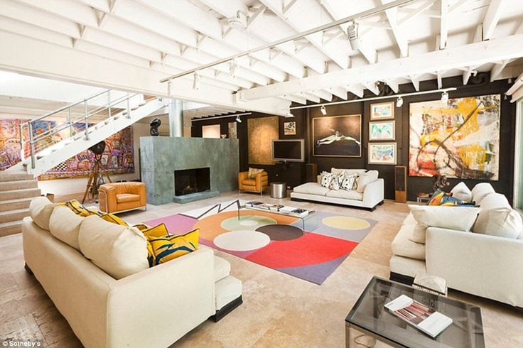 Anchored on travertine flooring, the spacious entertaining area features a magnificent ope...