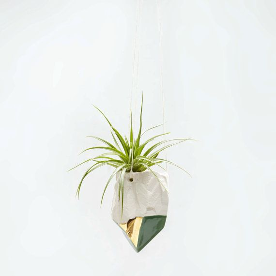 Slip cast from a handmade mold of a quartz crystal, these porcelain air plant hanging planters are perfect for your favorite air plants or