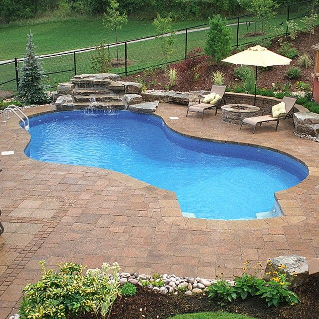 Waterfall, Inground pool and outdoor fire pit make for the ultimate summer backyard retreat