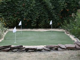 Building a Golf Putting Green : Outdoors : Home & Garden Television.  Add a hill and sandtrap
