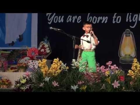 Rhinestone cowboy on stage by 8 years boy