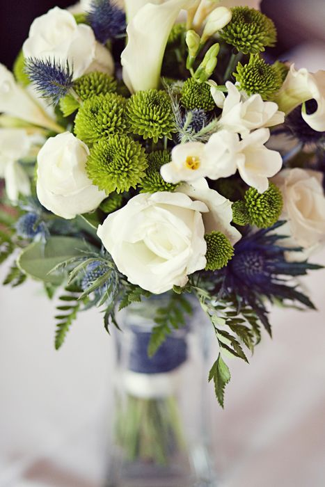 centerpiece with blue & green bouquet - would be pretty in mason jars