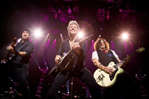 "Jon Bon Jovi, center, performs on stage with his Bon Jovi band mates John Shanks, left, and Phil X during opening night of the band's ""This House is Not For Sale"" tour at the Bon Secours Wellness Arena in Greenville, SC. Photo by David Bergman / TourPhotographer.com"