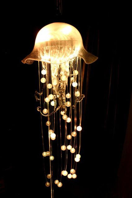 Jellyfish Chandelier by contemporarychandeliers: A bespoke creation, this jellyfish measures around 2 metres long, and has two lighting circuits. The primary circuit lights up the bowl and the acrylic spheres via fibre optics, the second lights up the glass tentacles. Created with sound reactive software so that the entire installation pulses with coordinated movement. #Chandelier #LED #Jellyfish