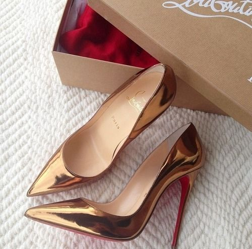 Gold pumps with red bottoms.