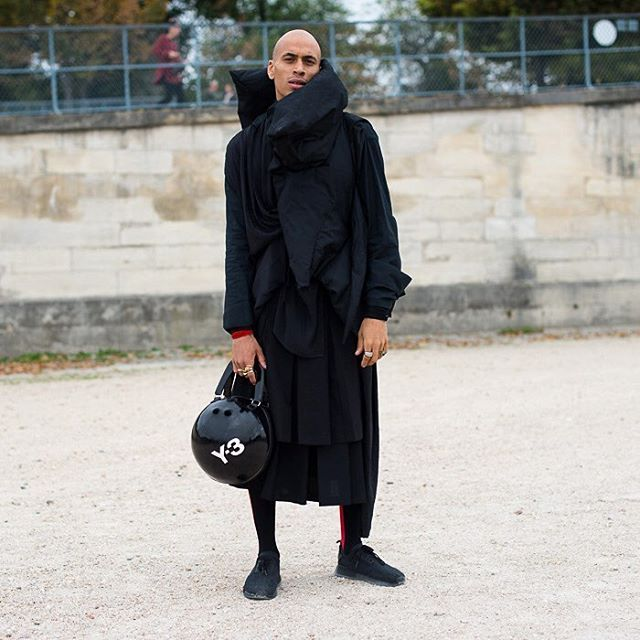 Pile it on: Patrick Mason @iampatrickmason in layers of inky black by Ann Demeulemeester and Rick Owens plus a bowling ball bag at the Paris shows. Photo by @gastrochic #PFW #fashion #streetstyle