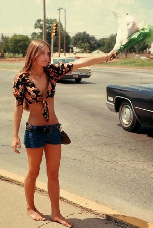 Girl selling flowers in the 70s I miss those shirts, I miss the hiphuggers but most of all I miss the body.
