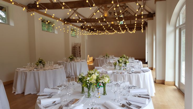 One beautiful wedding at Dorney Court within the Coach House Barn. Festoon Light Canopy, White Star Lit Dancefloor, and Lighting Prop
