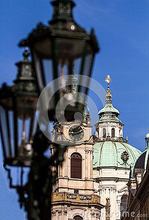 Lantern on the background Church of St. Nicholas in Prague, Czech Republic.