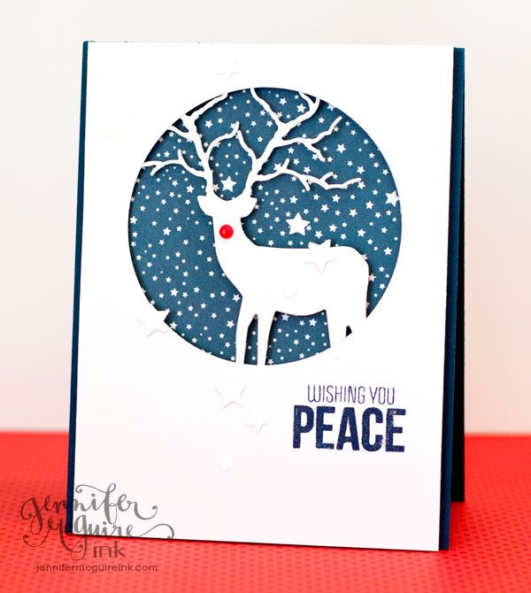 Layer a die cut behind a circle cutout of the card front - make sure part of the die cut is hidden behind the circle for a seamless look. Back all with patterned paper