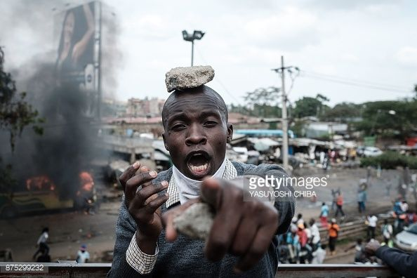 TOPSHOT - A supporters of Kenyan's opposition party National Super Alliance reacts during a demonstration following the arrival of opposition leader Raila Odinga to the Jomo Kenyatta Internation...Nov 2017