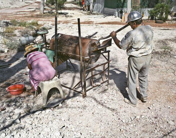 A miner and his wife dry puddling #opal dirt on their claim near #LightningRidge, circa #1994. #ThrowbackThursday http://www.trade.nsw.gov.au/legal/copyright