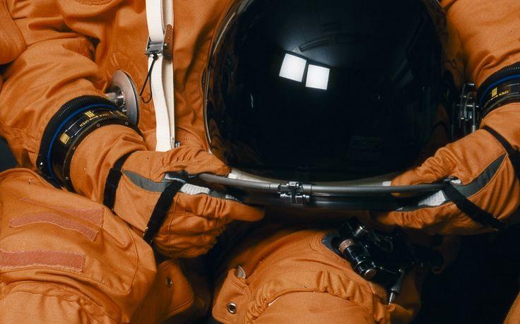 #astronaut helmet and suit - close up - brick red/orange