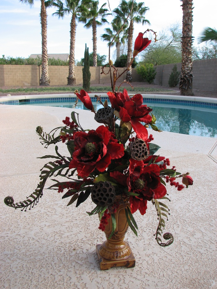 Red magnolia arrangement by Vickie Novak. Love this ...
