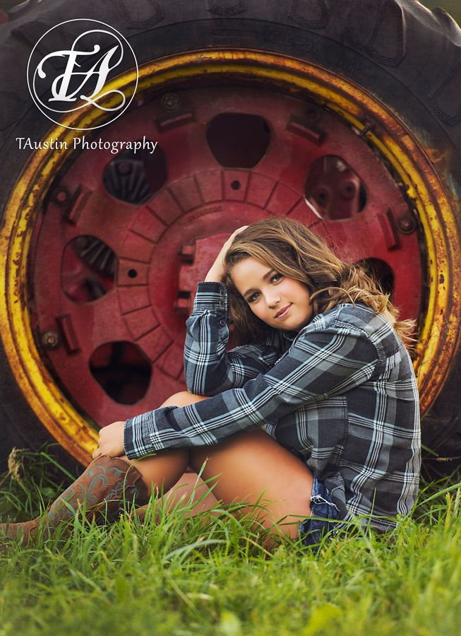 Senior Photo of a country girl by a tractor with cowboy boots    www.TAustinPhotography.com