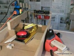 Thickness Planer - Homemade thickness planer comprised electric handheld planer mounted on its side on a workbench and parallel to a sliding fence.