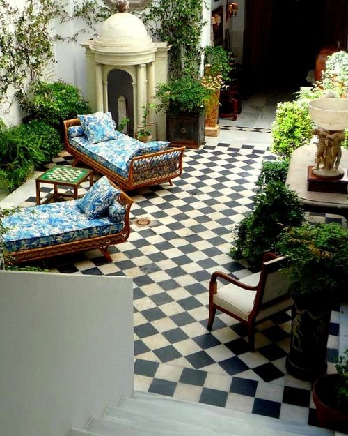 unusual use of toile on loungers on terrace