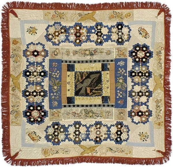 30 years a slave, 4 years at the White House. A quilt made by Elizabeth Keckley, a woman born into slavery who became a distinguished writer and seamstress. This quilt is said to be made from scraps of Mary Todd Lincoln's dresses.