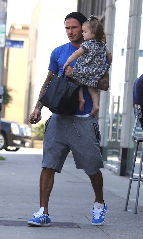 Soccer star David Beckham was spotted running errands with his daughter Harper Seven in Los Angeles. He was seen wearing a light blue tee, Adidas Originals by DB sweat shorts ($108), and matching blue Adidas Gazelle sneakers.