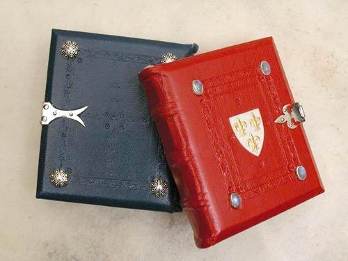 Randy Asplund Art Joan of Arc Miniature Books. Randy makes authentic re-made books and many other arts. Amazing :-)