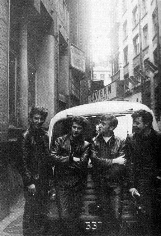 1961. The Beatles, with Pete Best, leaning against Alan William's van outside…