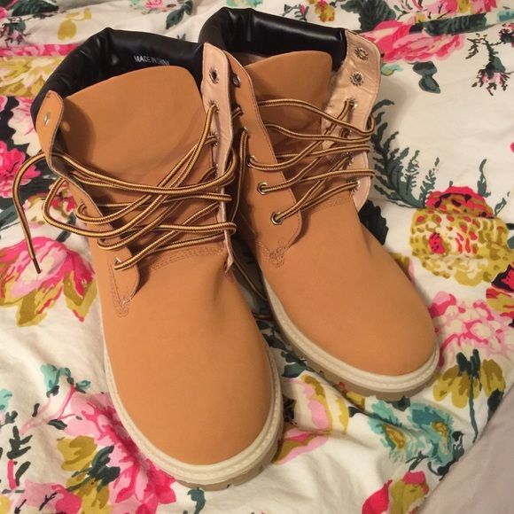 Fake TIMBERLANDS. NEVER WORN!! Women work boots These are the fake timberland boots. Super cute. Never worn. Size 10. Black poppy brand. Black Poppy Shoes