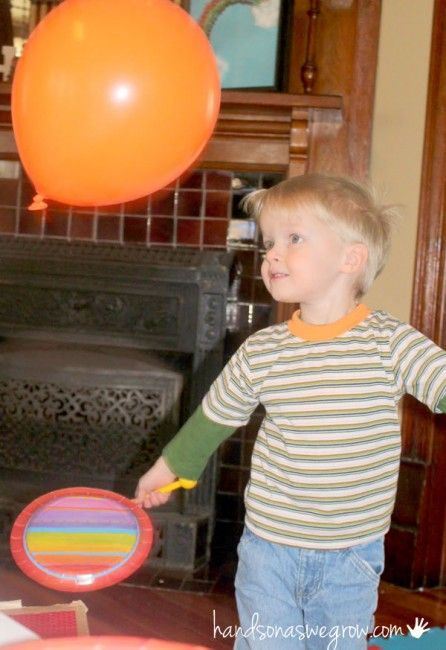 Hit the balloon (hand-eye coordination) Keep the balloon off the ground (balance/steadiness) Hit the balloon back and forth to each other across the play table or other object (team play)