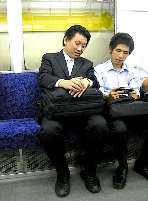 Tokyoite can be spotted riding the train PLAYING PSP showing off they're mad skills to they're neighbors if someone happens to be sitting in the next seat. As you can see two strangers meet to discuss the commons good, a past and future build on playing videos games with enough hardware build into your hands that would make 1960s supercomputer experts freak and praise the cult of technology for bringing forth something that would make your game boy pee in it's pants. What Would Tokyoites Do?…